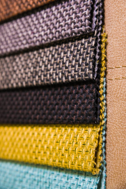 Colorful and bright fabric samples of furniture and clothing upholstery. Close-up of a palette of textile abstract stripes of different colors stock photo