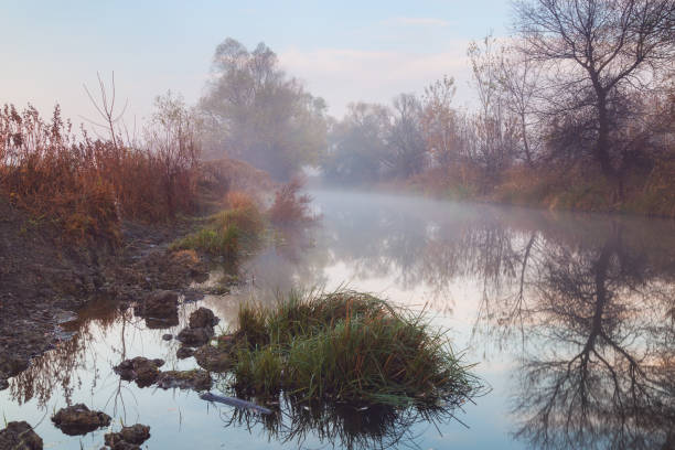 Colorful and hazy morning over narrowriver stock photo