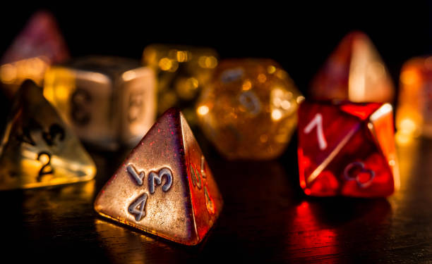 Colorful and shiny role playing dices close-up on a dark background. RPG or board game concept. stock photo