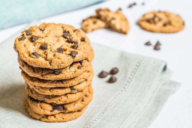 Colorful and tasty chocolate chips cookie. Concept of sweet food and dessert. Colorful and tasty chocolate chips cookie. Concept of sweet food and dessert. chocolate chip cookie stock pictures, royalty-free photos & images