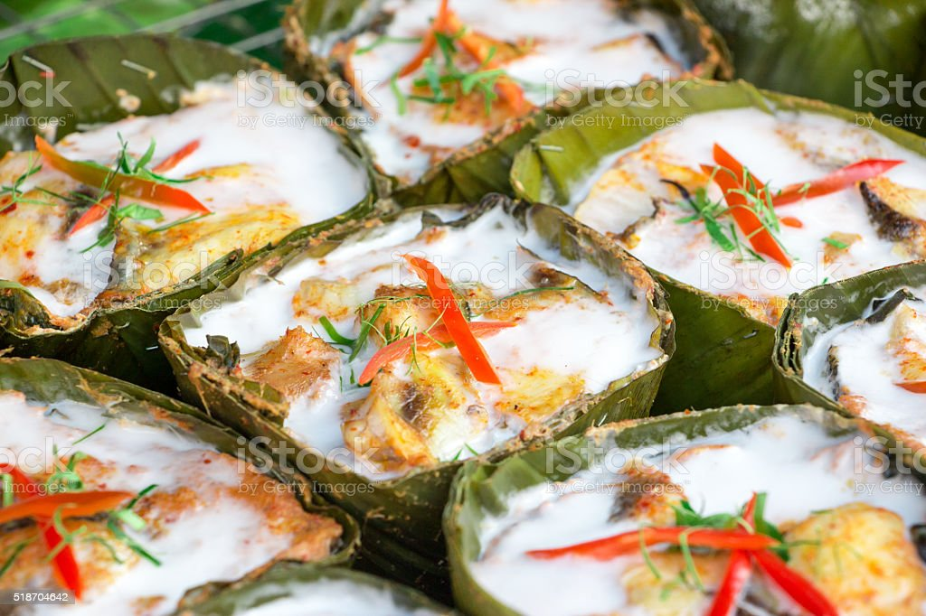 Colorful and tasty steamed seafood in curry coconut paste stock photo