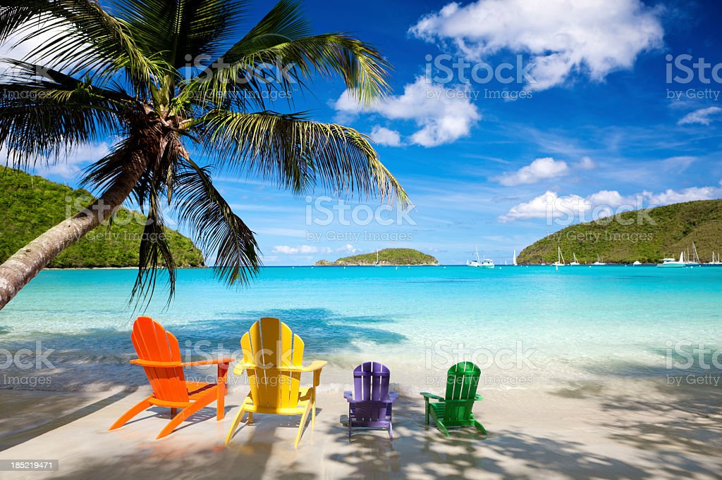 colorful andirondack chairs at a Caribbean beach stock photo