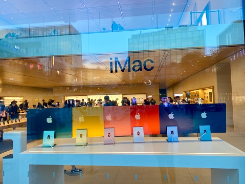 Beijing, China - 26 May, 2021: Brand new 2021 colorful iMac's in Apple Store. Customers are waiting in line to get new products from Apple.