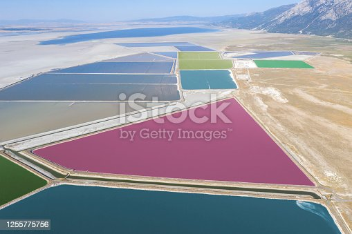 Aerial view of colorful Aquaculture ponds. Taken via drone. Acigol Lake ( Acı Göl) in Turkey.