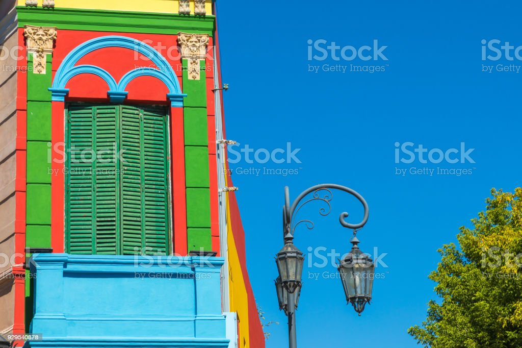 Colorful area in La Boca neighborhoods in Buenos Aires. Street is a major tourist attraction & the area is filled with colorfully painted buildings. stock photo
