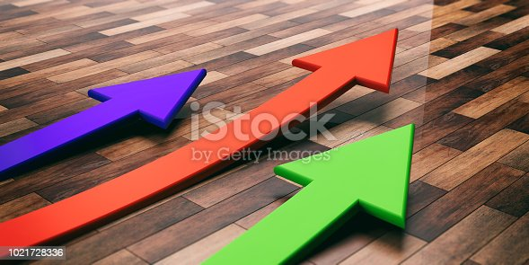 istock Colorful arrows on wooden background. 3d illustration 1021728336