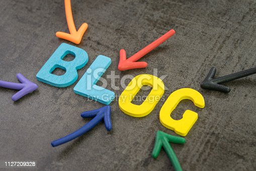 istock Colorful arrows pointing to the word BLOG at the center of black chalkboard wall, Blog, web logs online article and website concept, new job for writing article and publish to the internet 1127209328