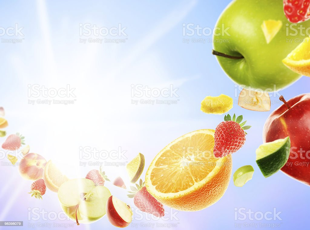 Colorful art of cascading fruits, in a sunbeam royalty-free stock photo