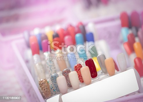 istock Colorful artificial Nails in nail salon shop. Set of false nails for customer to choose color for manicure or pedicure in nail salon and spa shop. Nails art and design. Sample nail polish palette. 1132185902