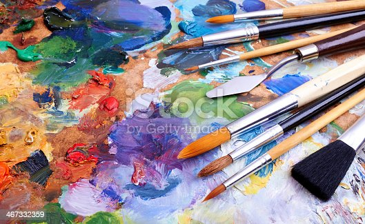 istock Colorful artist brushes and paint 467332359