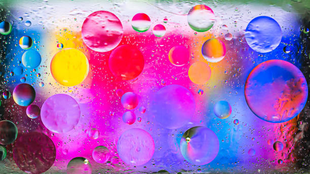 Colorful artistic image of oil drop on water stock photo