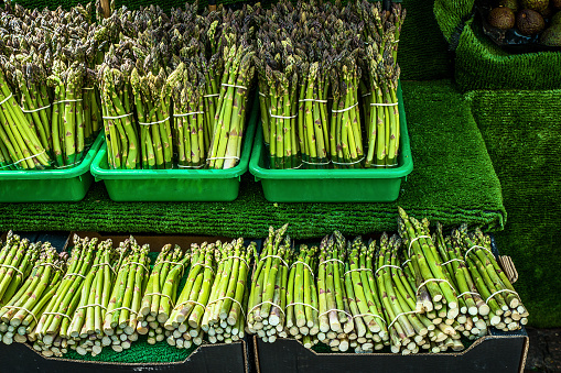 istock Colorful asparagi stand in open air market 1039002156