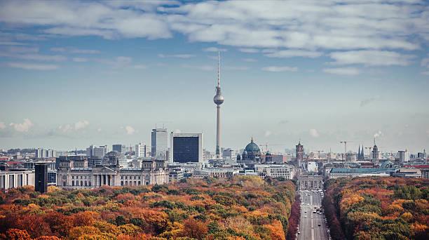 colorful autumn berlin cityscape seen from victory column - グローサーシュテルン広場 ストックフォトと画像