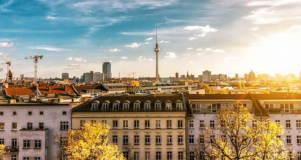 colorful autumn berlin cityscape seen from zionskirche - berliner fernsehturm stock-fotos und bilder
