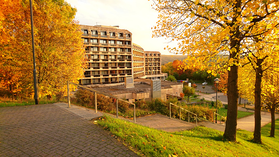 Colorful autumn landscape in Bad Ems. Rehabilitation clinic Lahntalklinik surrounded by trees with yellow leaves.