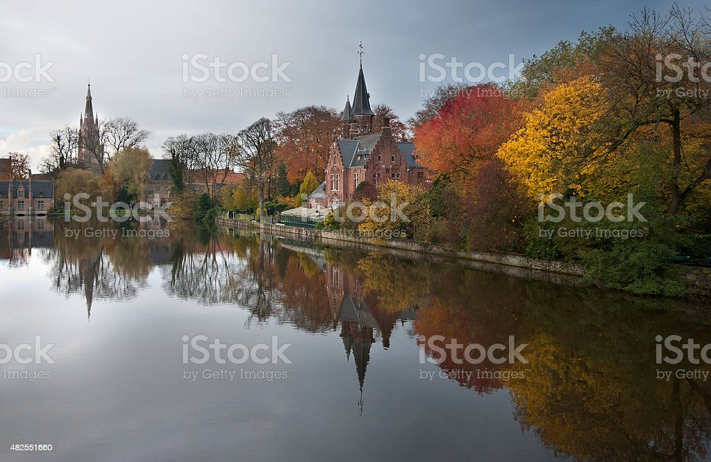 Colorful autumn reflections of trees in the water, Bruges, Belgium stock photo