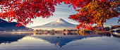 istock Colorful Autumn Season and Mountain Fuji with morning fog and red leaves at lake Kawaguchiko is one of the best places in Japan 1228962068