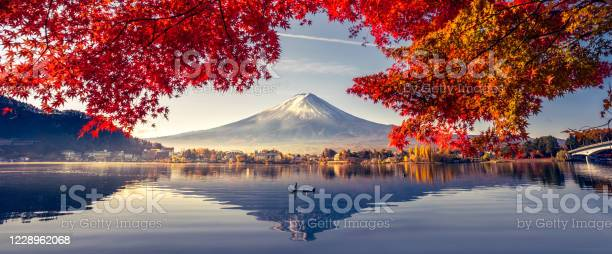 Photo of Colorful Autumn Season and Mountain Fuji with morning fog and red leaves at lake Kawaguchiko is one of the best places in Japan