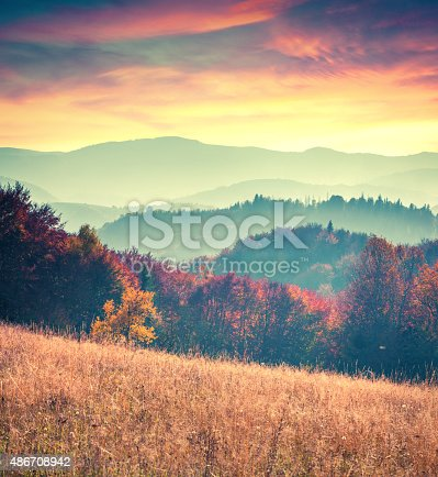 Colorful autumn sunrise in the Carpathian mountains. Sokilsy ridge, Ukraine, Europe. Retro style.