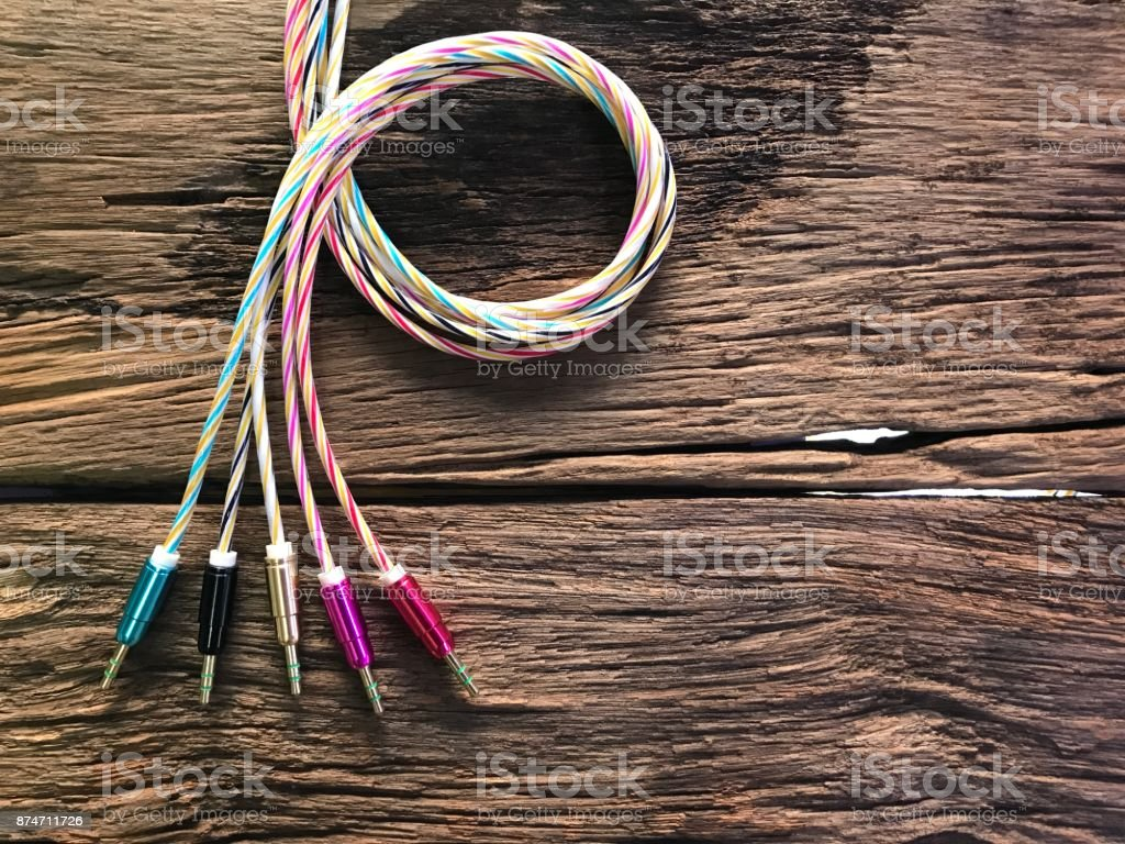Colorful auxiliary lines on old wood floor with the concept of technology, cable, mobile peripherals, entertainment, modernity, advancement, connectivity. stock photo