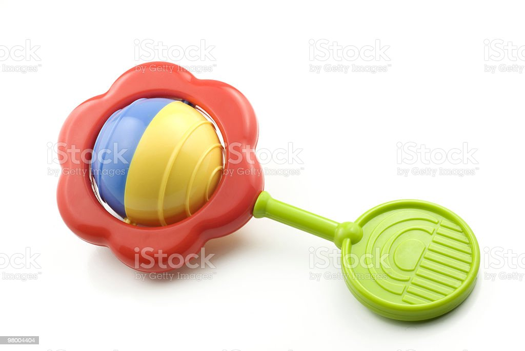 Colorful baby rattle over white background stock photo