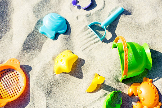 Colorful baby sand toys on the beach stock photo