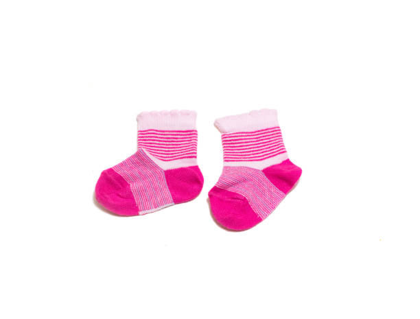 Colorful baby socks isolated on white background stock photo