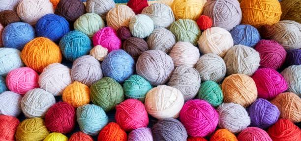 colorful background made of wool yarn balls. - a maglia foto e immagini stock