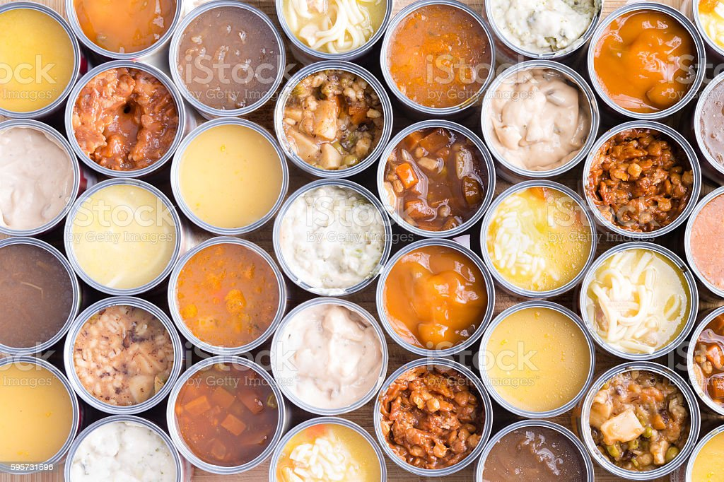 Colorful background of opened cans of soup stock photo