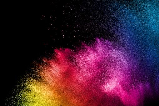 istock Colorful background of pastel powder.Multi colored dust splash on black background.Painted Holi. 1174831348