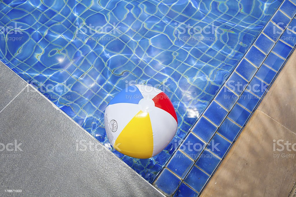 Colorful ball floating in swimming pool royalty-free stock photo
