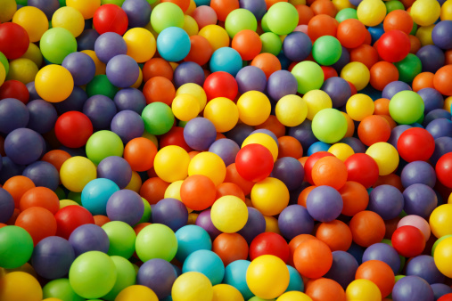 Part of multicoloured balls in a childrens ball pit  - Full Frame.
