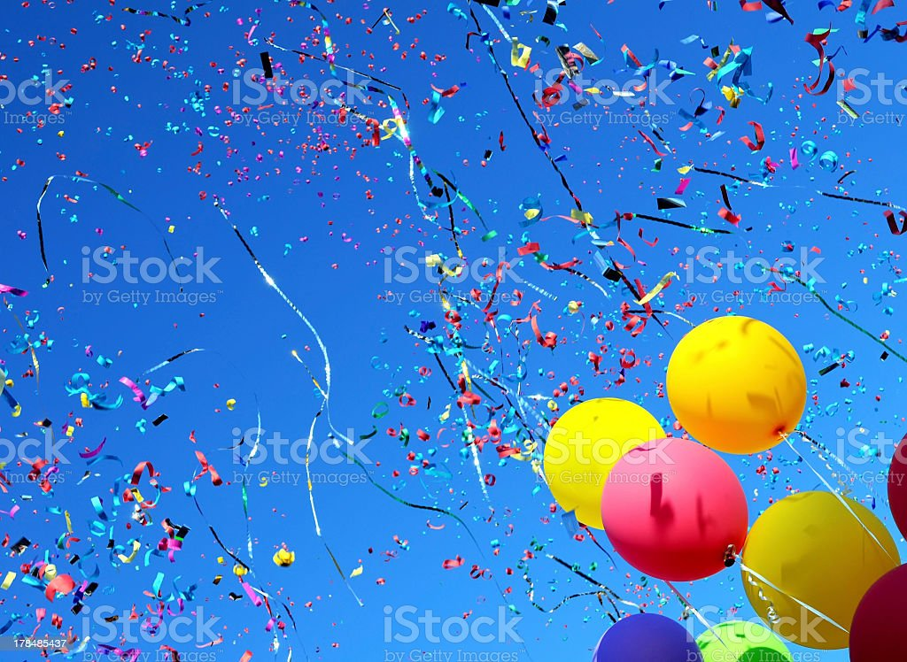 Colorful balloons and confetti on blue sky stock photo