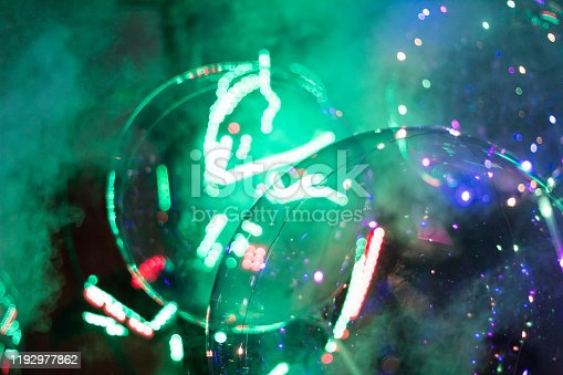 Colorful bubbles and smoke with robot background during a birthday party