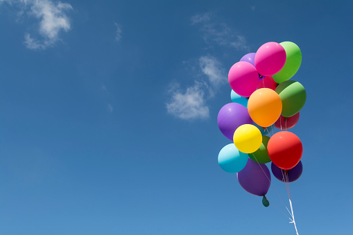 Colorful balloons flying in the blue sky