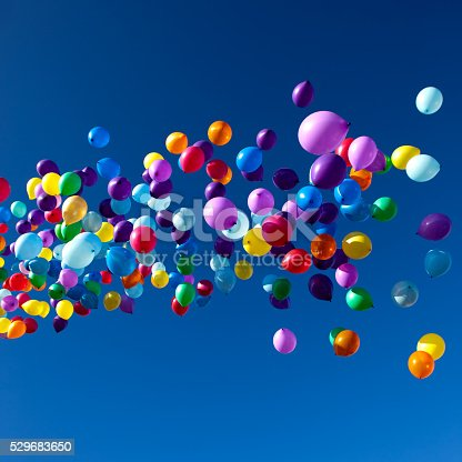 istock Colorful Balloons flying in the sky party 529683650