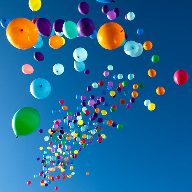 Colorful Balloons flying in the sky party stock photo