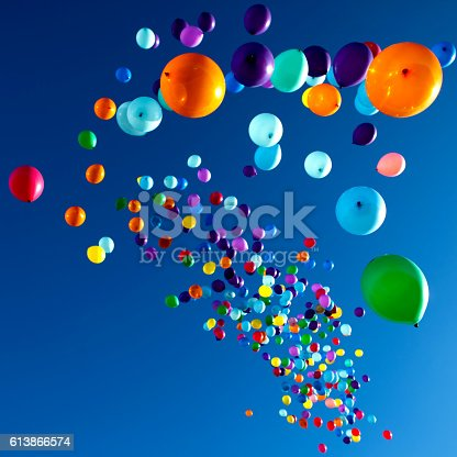 istock Colorful Balloons flying in the sky party 613866574