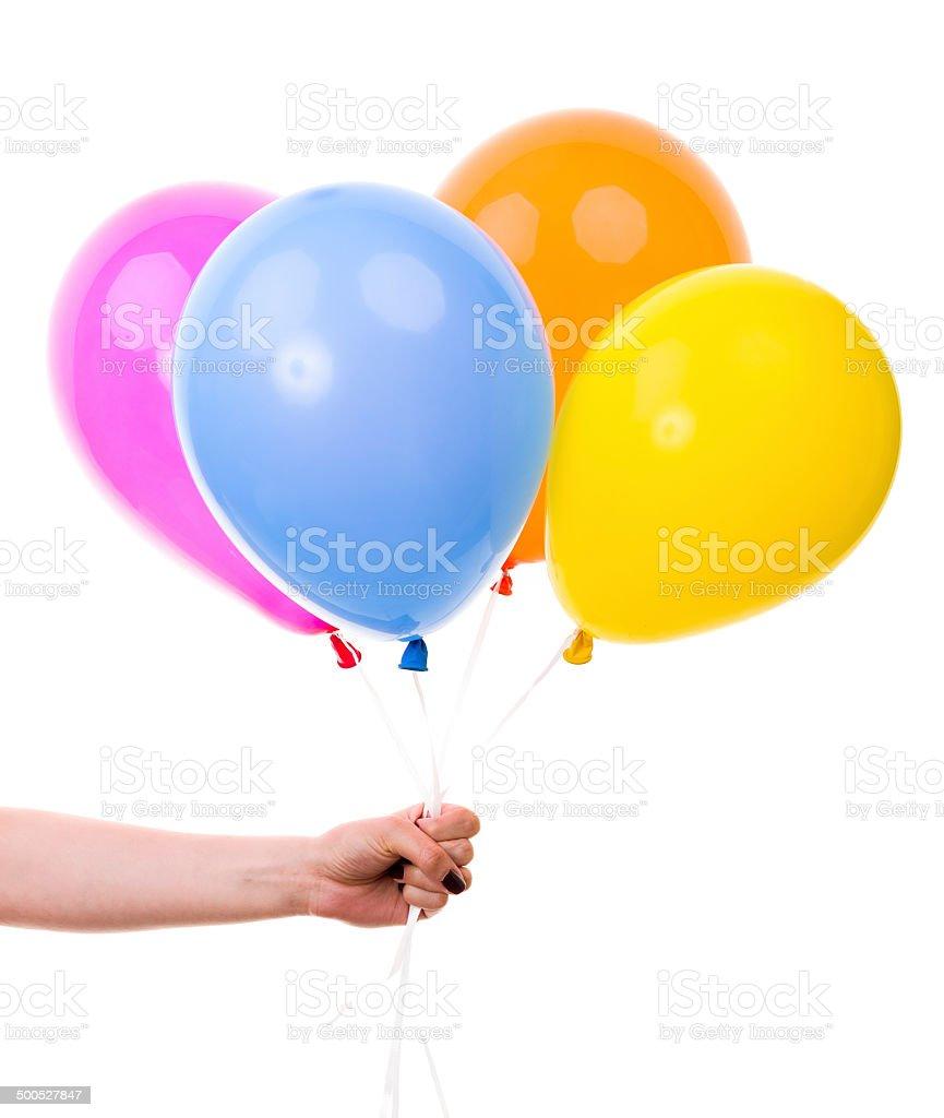 Bunte Ballons, über weibliche Hand.  Auf weißem Hintergrund – Foto