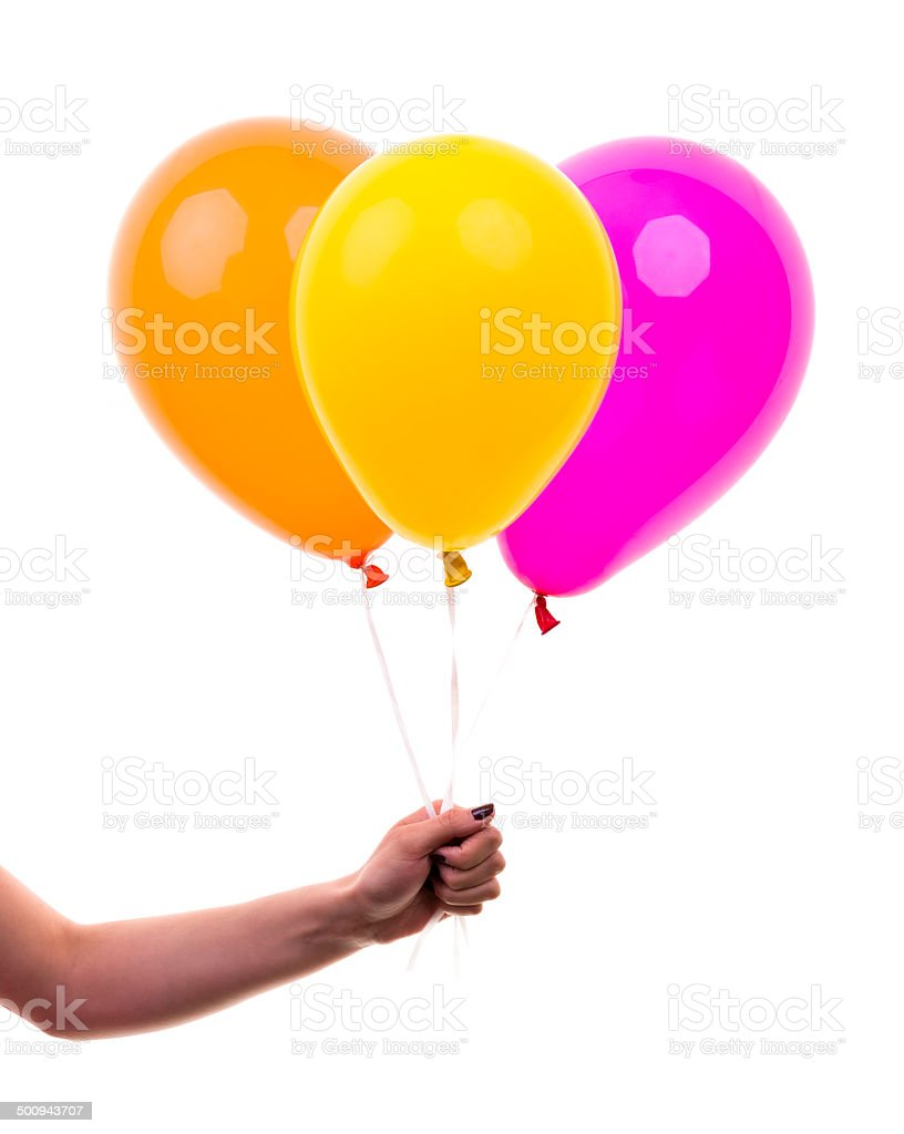 Colorful Balloons held by Female Hand. On White Background stock photo