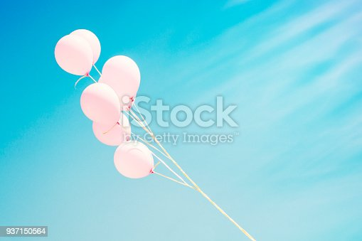 945748362 istock photo Colorful balloons in a clear blue sky 937150564