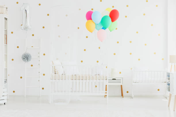 Colorful balloons in baby room stock photo