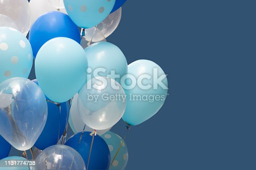 colorful balloons on blue background. happy new year and happy birthday concept