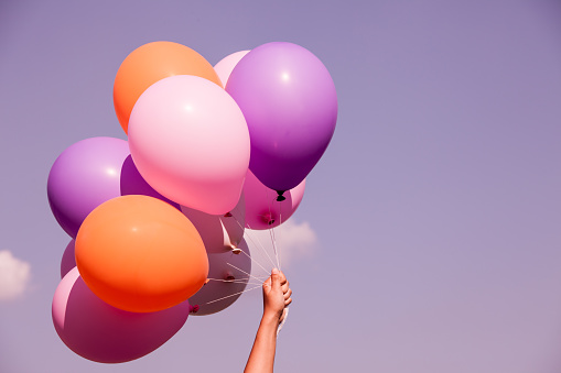 Colorful balloons on sky background in purple color tone