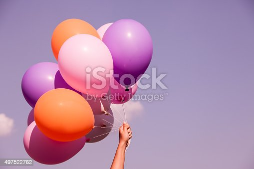 istock Colorful balloons on sky background in purple color tone 497522762