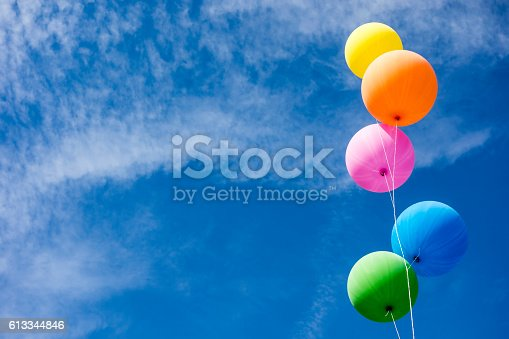 istock Colorful Balloons Over Sky 613344846