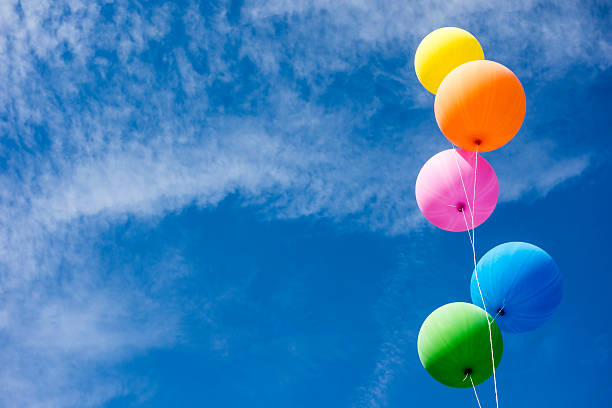 Colorful Balloons Over Sky - foto de acervo