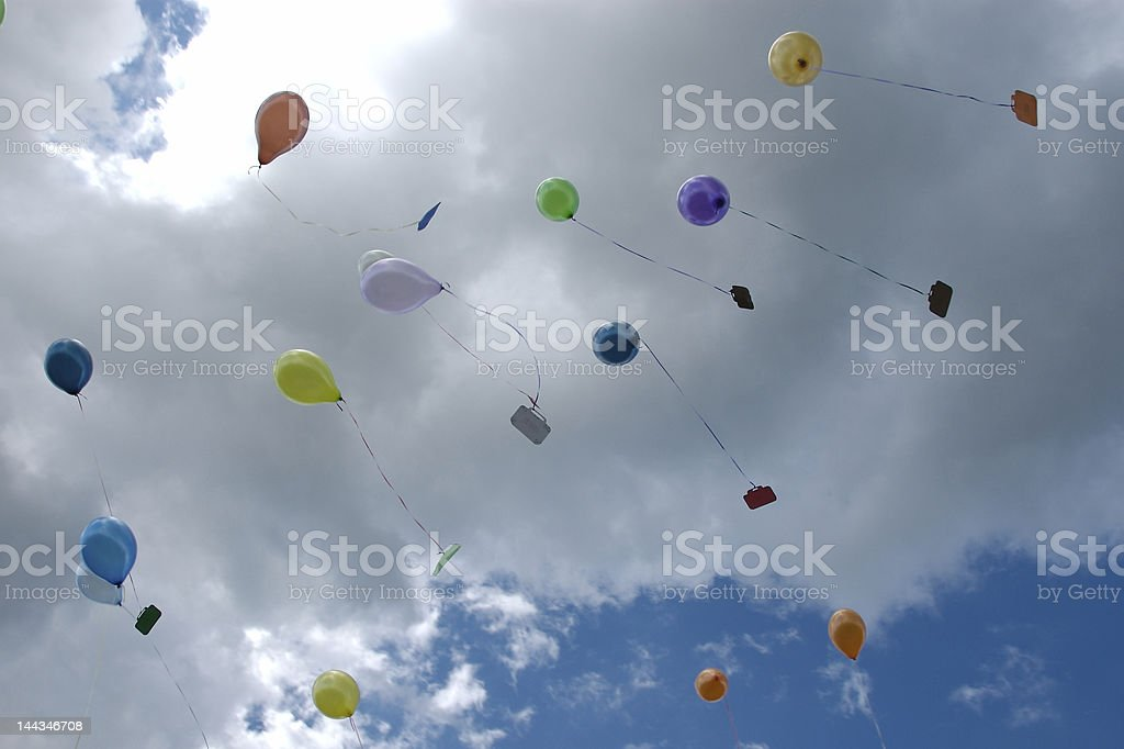 Colorful Balloons Rising in the Sky royalty-free stock photo