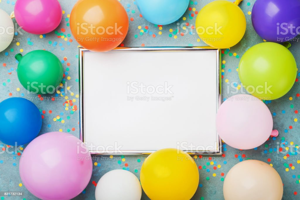 Colorful balloons, silver frame and confetti. Birthday or party mockup for planning. Flat lay style. Copy space for text. Festive greeting card. stock photo