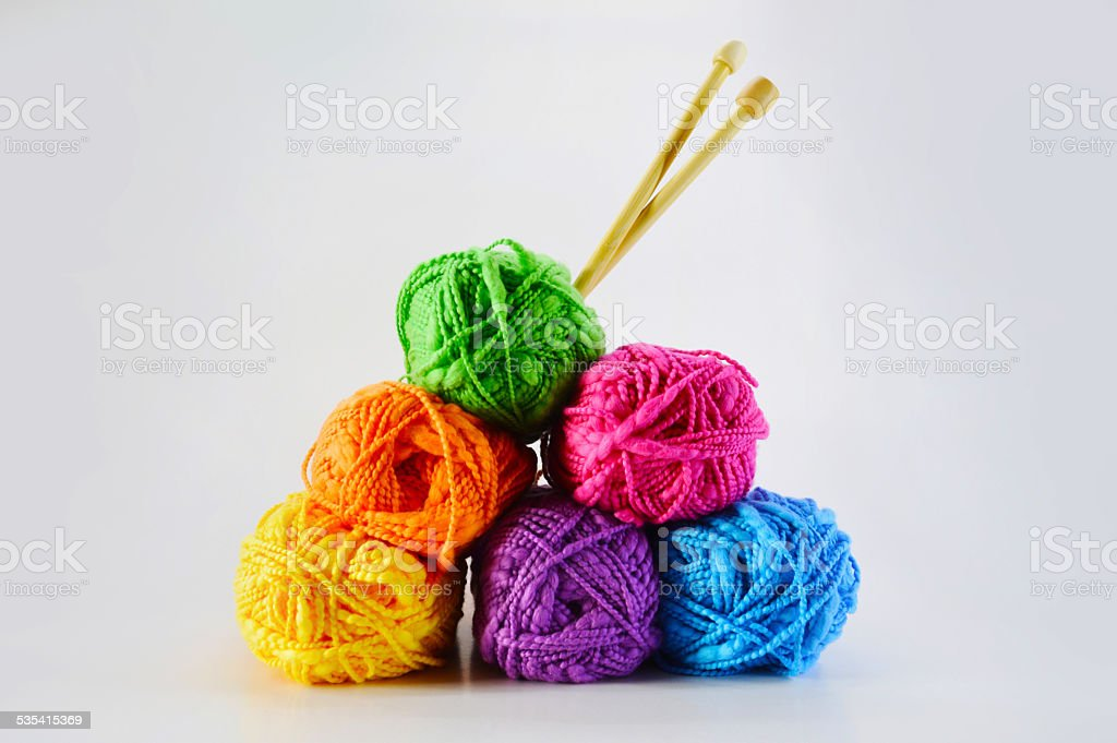 Colorful balls of wool with sticks stock photo